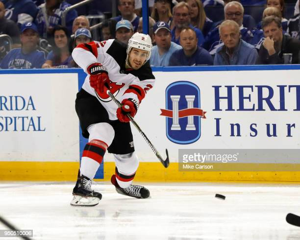 John Moore of the New Jersey Devils shoots against the Tampa Bay Lightning in the first period of Game Five of the Eastern Conference First Round...