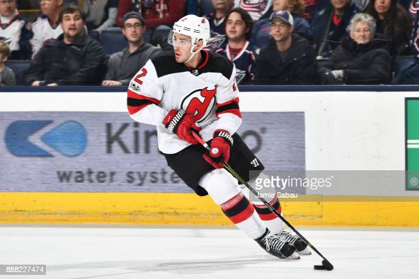 John Moore of the New Jersey Devils skates against the Columbus Blue Jackets on December 5 2017 at Nationwide Arena in Columbus Ohio