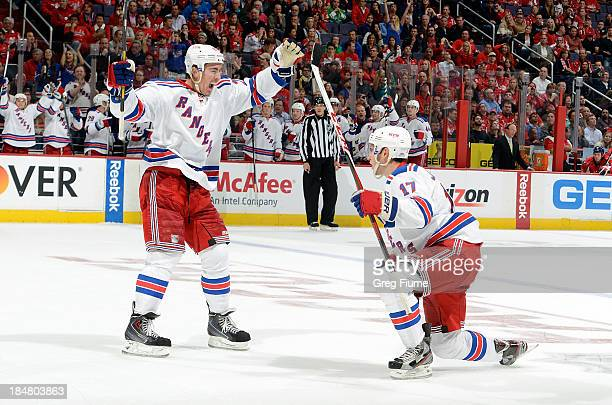 John Moore of the New York Rangers celebrates with Ryan McDonagh after scoring in the second period against the Washington Capitals at the Verizon...