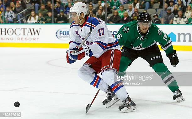 John Moore of the New York Rangers controls the puck against Ryan Garbutt of the Dallas Stars in the first period at American Airlines Center on...