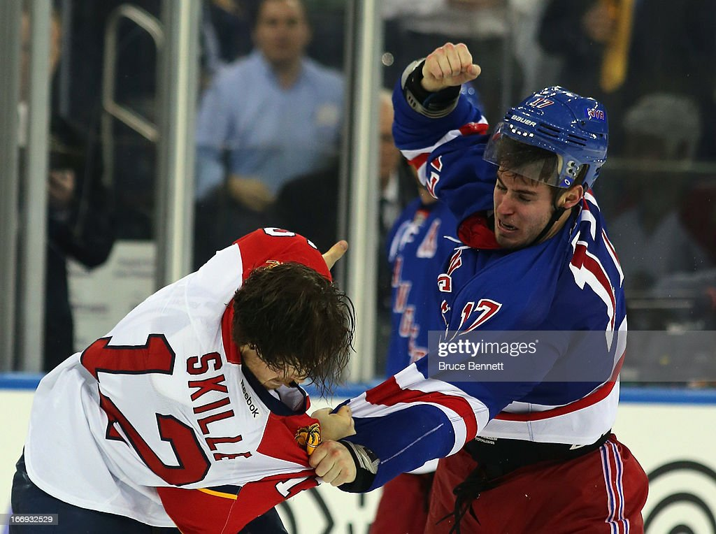John Moore #17 of the New York Rangers pulls the helmet off of Jack Skille #12 of the Florida Panthers during a third period fight at Madison Square Garden on April 18, 2013 in New York City. The Rangers defeated the Panthers 6-1.