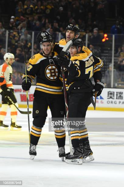 John Moore, Zdeno Chara and Jake DeBrusk of the Boston Bruins celebrate a goal against the Philadelphia Flyers at the TD Garden on October 25, 2018...