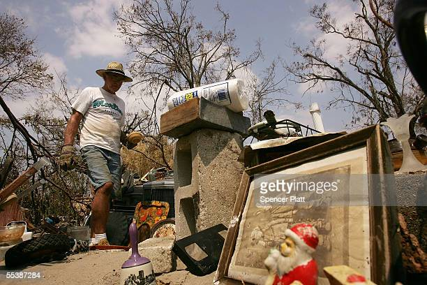 John Moorer salvages items from the yard where his home once stood before Hurricane Katrina destroyed it September 12 2005 in Biloxi Mississippi...