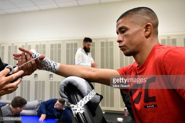 John Moraga has his hands wrapped prior to his bout against Deiveson Figueiredo of Brazil during the UFC Fight Night event at Pinnacle Bank Arena on...