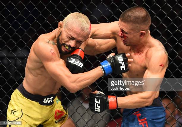 John Moraga punches Deiveson Figueiredo of Brazil in their flyweight fight during the UFC Fight Night event at Pinnacle Bank Arena on August 25 2018...