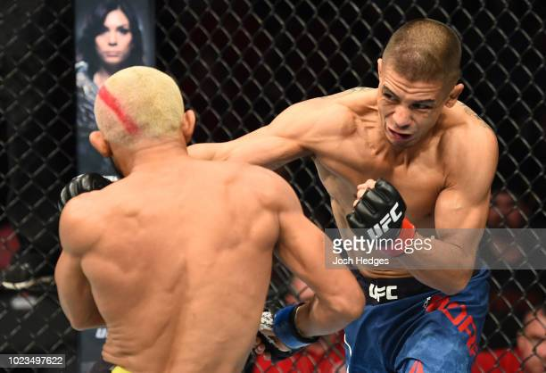 John Moraga punhces Deiveson Figueiredo of Brazil in their flyweight fight during the UFC Fight Night event at Pinnacle Bank Arena on August 25 2018...