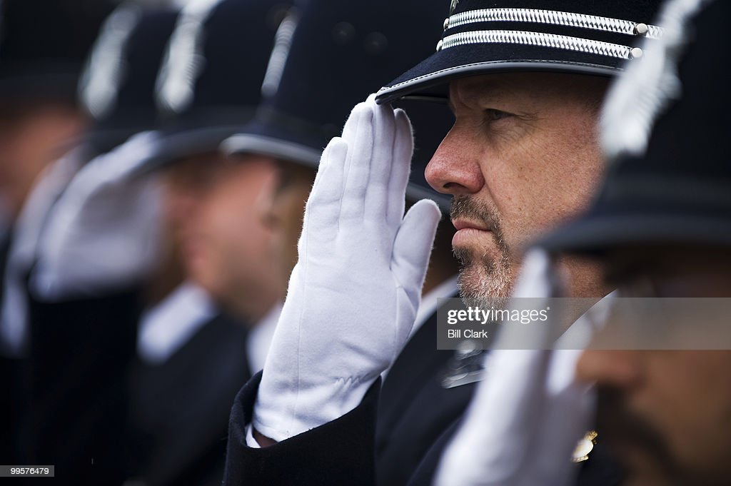 John Moran, of the London Metropolitan Police Service, and his fellow officers from London salute on Monday, May 11, 2009, during the Metropolitan Police Department 30th Annual Memorial Service for Officers Killed in the Line of Duty, held at the Washington Area Law Enforcement Memorial Fountain on Indiana Ave. NW.