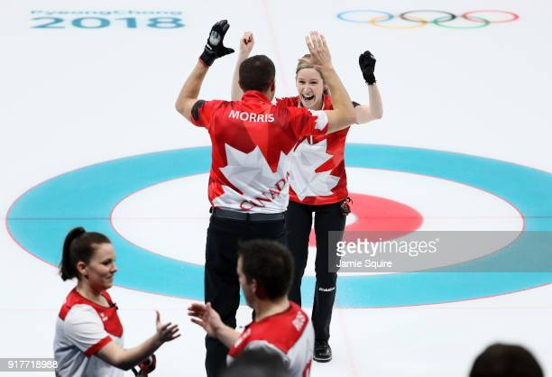 John Morris and Kaitlyn Lawes of Canada celebrate defeating Switzerland to win the gold medal during the Curling Mixed Doubles Gold Medal Game on day...