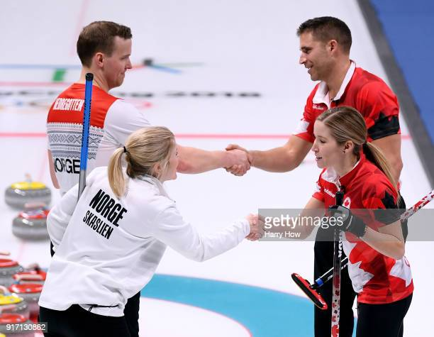 John Morris and Kaitlyn Lawes of Canada shake hands with Magnus Nedregotten and Kristin Skaslien of Norway after an 84 win to advance to the gold...