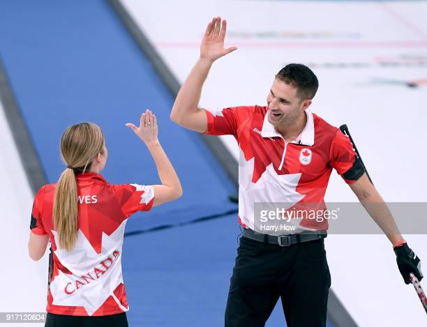 John Morris of Canada celebrates an 84 win over Norway with Kaitlyn Lawes during the Curling Mixed Doubles SemiFinals Session One at Gangneung...