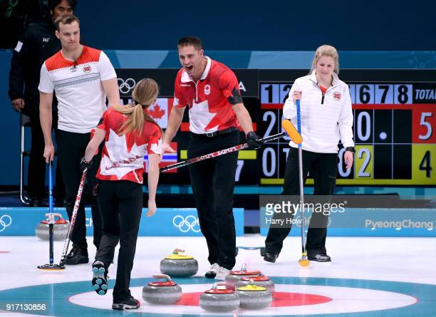 John Morris of Canada reacts to a shot from Kaitlyn Lawes to score three in the seventh end in front of Magnus Nedregotten and Kristin Skaslien of...