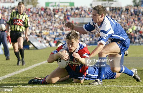John Morris of the Knights scores a try during the NRL round 20 game between the Newcastle Knights and the Bulldogs held at Energy Australia Stadium...