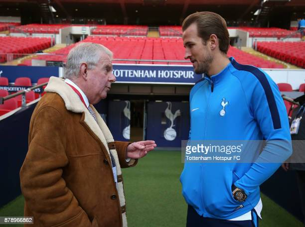 John Motson speak with Harry Kane of Tottenham Hotspur prior to the Premier League match between Tottenham Hotspur and West Bromwich Albion at...