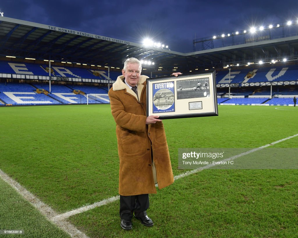 John Motson with a momento to commemorate his last game as commentator at Goodison Park after the Premier League match between Everton and Crystal Palace at Goodison Park on February 10, 2018 in Liverpool, England.