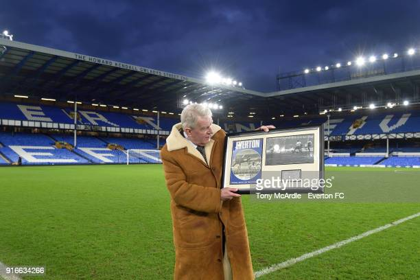 John Motson with a momento to commemorate his last game as commentator at Goodison Park after the Premier League match between Everton and Crystal...