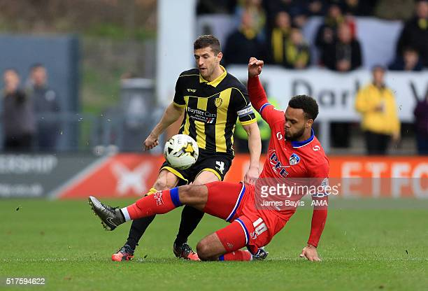 John Mousinho of Burton Albion and Aaron ArmadiHolloway of Oldham Athletic in action during the Sky Bet League One match between Burton Albion and...