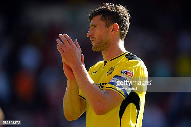 John Mousinho of Burton Albion applauds the fans at the end of the Sky Bet Championship match between Nottingham Forest and Burton Albion at City...