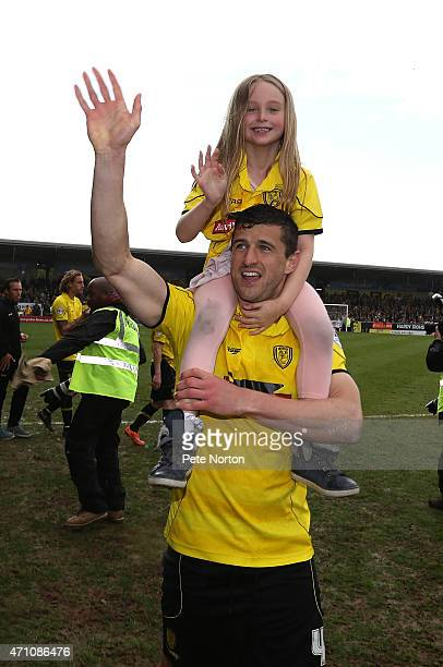 John Mousinho of Burton Albion celebrates with his daughter on a lap of honour at the end of the Sky Bet League Two match between Burton Albion and...