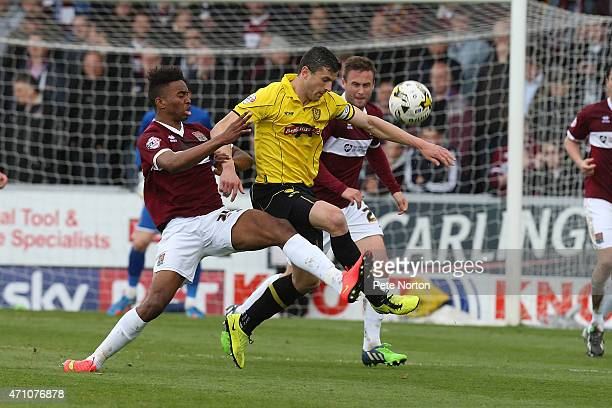 John Mousinho of Burton Albion contests the ball with Ivan Toney of Northampotn Town during the Sky Bet League Two match between Burton Albion and...