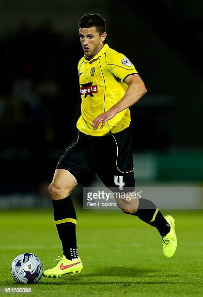 John Mousinho of Burton in action during the Capital One Cup Second Round match between Burton Albion and Queens Park Rangers at Pirelli Stadium on...