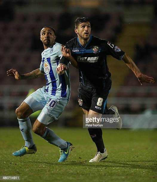 John Mousinho of Stevenage and Callum Wilson of Coventry City in action during the Sky Bet League One match between Coventry City and Stevenage at...