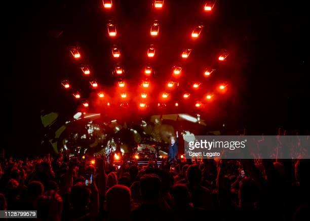 John Moyer Mike Wengren David Draiman and Dan Donegan of Disturbed perform at Little Caesars Arena on March 05 2019 in Detroit Michigan