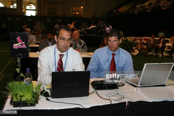 John Mozeliak, left and Alan Benes of the St. Louis Cardinals work during the 2007 First-year player draft at The Milk House in Disney's Wide World...