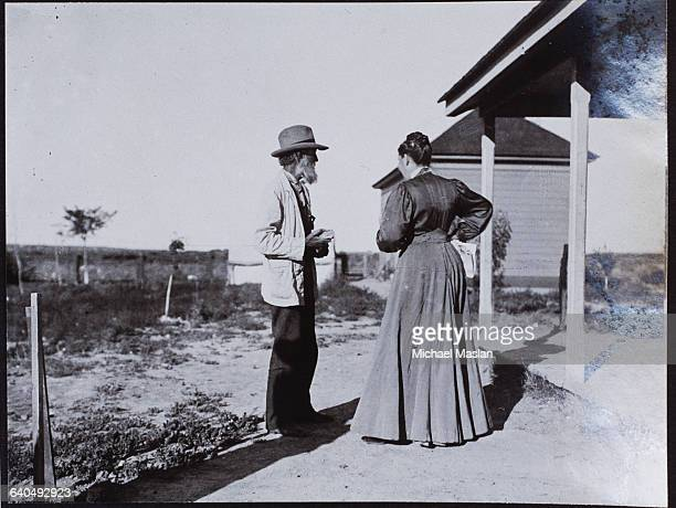 John Muir naturalist and proponent of national parks in the United States talks to a woman outdoors