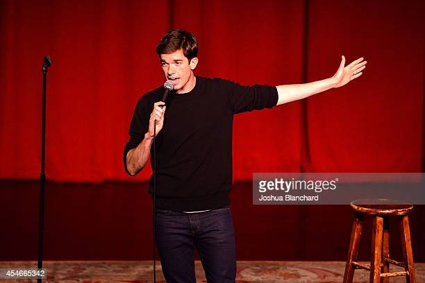John Mulaney performs at the Mulaney premiere event at Largo at the Coronet on September 4 2014 in Los Angeles California