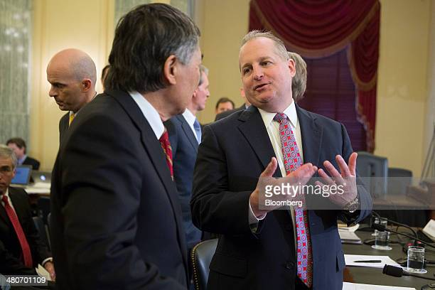 John Mulligan executive vice president and chief financial officer of Target Corp right talks to Wallace Loh president of the University of Maryland...