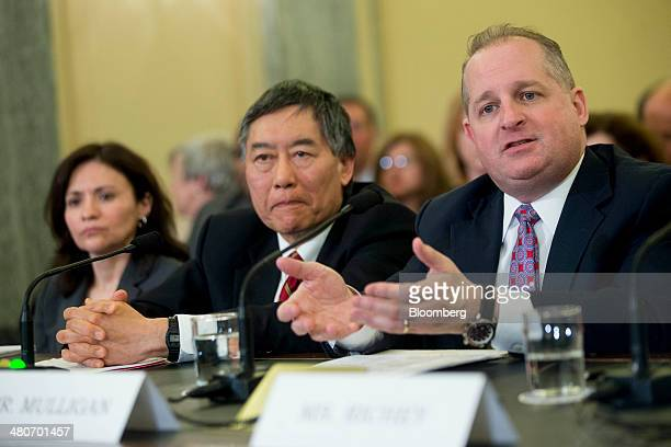 John Mulligan executive vice president and chief financial officer of Target Corp from right Wallace Loh president of the University of Maryland and...