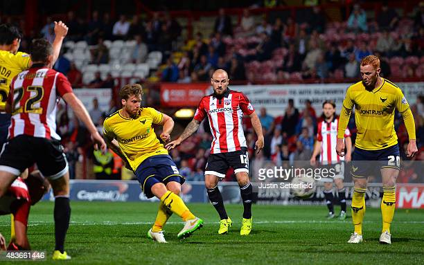 John Mullins of Oxford United scores Oxford's 4th goal during the Capital One Cup First Round match between Brentford and Oxford United at Griffin...