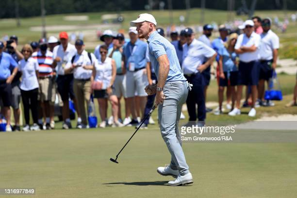 John Murphy of Team Great Britain and Ireland celebrates on the 18th green during Day One of The Walker Cup at Seminole Golf Club on May 08, 2021 in...