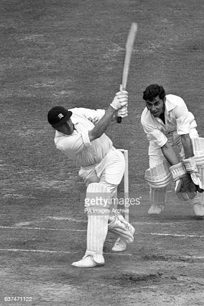 John Murray hits a four against Lancashire for Middlesex Also pictured is Lancashire's wicketkeeper Farokh Engineer