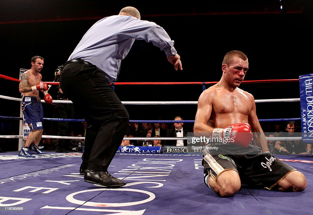 John Murray is knocked down by Kevin Mitchell during the vacant WBO Inter-Continental Lightweight Championship bout at Echo Arena on July 16, 2011 in Liverpool, England.