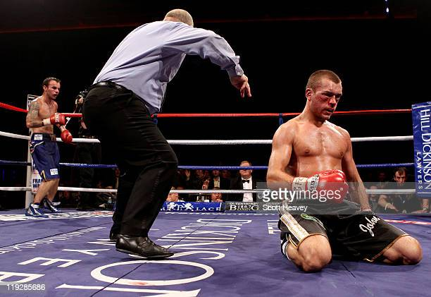 John Murray is knocked down by Kevin Mitchell during the vacant WBO Inter-Continental Lightweight Championship bout at Echo Arena on July 16, 2011 in...