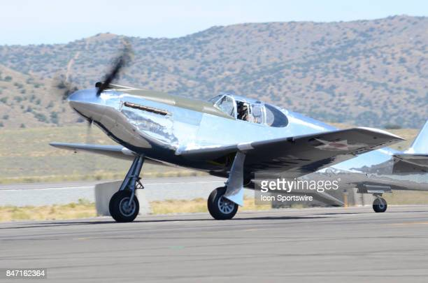 John Muszala 11 pilot of the No 6 P51A Mustang heads out to the runway at the 54th National Championship Air Races the only closed course pylon...