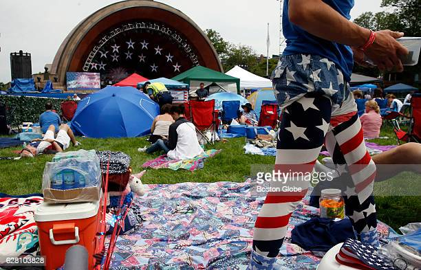John Myron of Berkley cleans up his space as he waits for the Fourth of July festivities to begin on the Charles River Esplanade in Boston on Jul 4...