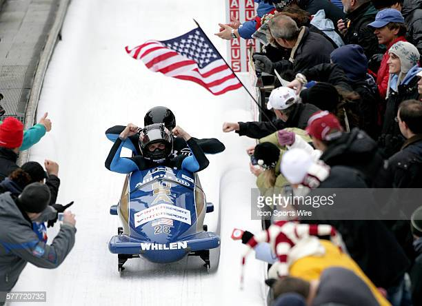 John Napier and Charles Berkeley of the USA fly through the 'Shady' corner enroute to a 1st place finish in the two-man bobsled at the Federation...