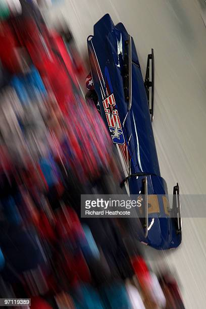 John Napier, Charles Berkeley, Steven Langton and Christopher Fogt of the United States compete in USA 2 compete during the four-man bobsleigh heat 2...