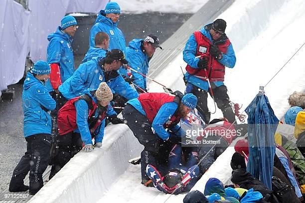 John Napier, Charles Berkeley, Steven Langton and Christopher Fogt of the United States crash in USA 2 during the four-man bobsleigh heat 2 on day 15...