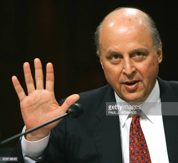 John Negroponte holds up 5fingers when asked how many times he has been confirmed by the US Senate for prior jobs in prior administrations during his...