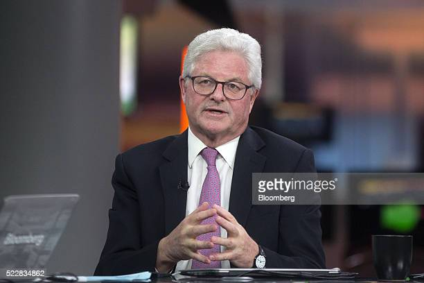 John Nelson chairman of Lloyd's of London gestures whilst speaking during a Bloomberg Television interview in London UK on Thursday April 21 2016...