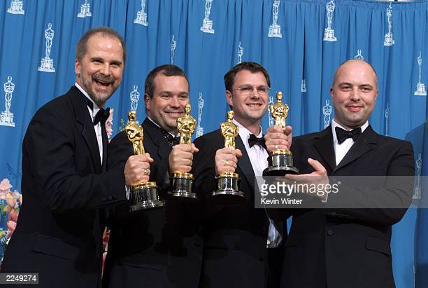 John Nelson, Neil Corbould, Tim Burke and Rob Harvey, left to right, with Oscars for Achievement in Visual Effects for 'Gladiator,' at the 73rd...