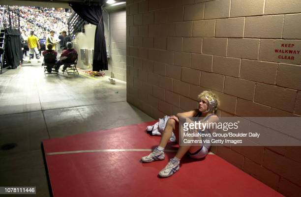John Ness Broomfield High School takes a moment by himself after loosing to Tony Mustari Greeley Central High School in the class 4A 112 pound...