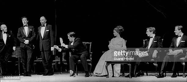 MAR 4 1964 MAR 6 1964 John Nettleton seated left as Henry VIII conducts The King's Hunt Standing are the singers from left Stephen Manton Raymond...