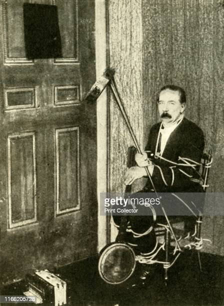 John Nevil Maskelyne performs a 'spirit cabinet illusion' circa 1910 'How the tricks are performed A coachhorn or megaphone is useful for picking...