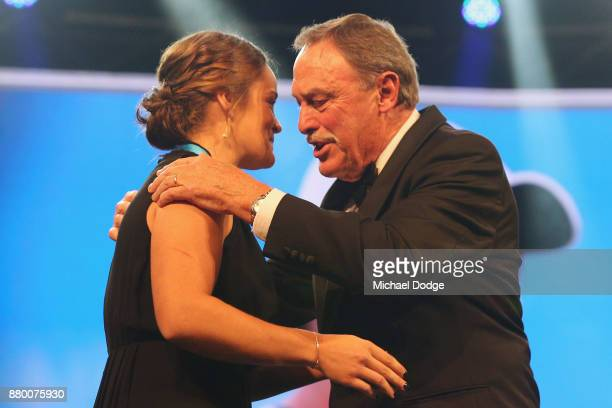 John Newcombe medallist Ashleigh Barty accepts her award on the podium from John Newcombe at the 2017 Newcombe Medal at Crown Palladium on November...