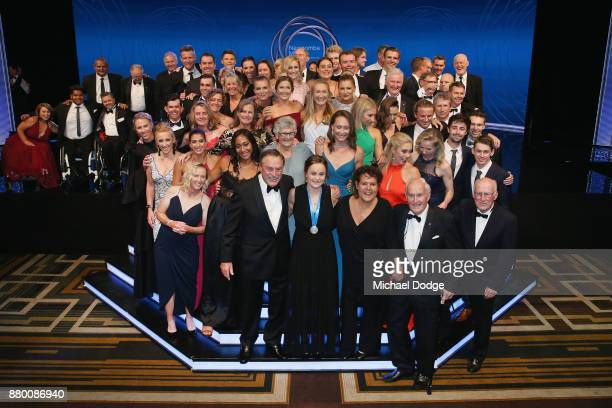 John Newcombe medallist Ashleigh Barty pose with other tennis players and officials at the 2017 Newcombe Medal at Crown Palladium on November 27 2017...