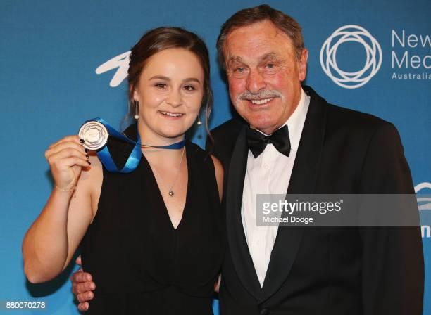 John Newcombe medallist Ashleigh Barty poses with John Newcombe at the 2017 Newcombe Medal at Crown Palladium on November 27 2017 in Melbourne...